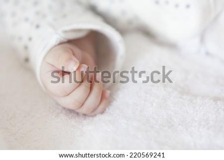 Newborn baby's hand - stock photo