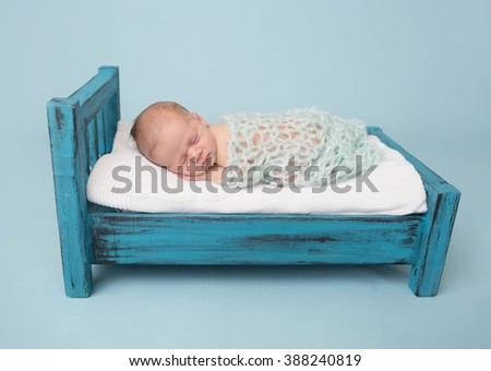 Newborn baby sleeping, asleep on bed