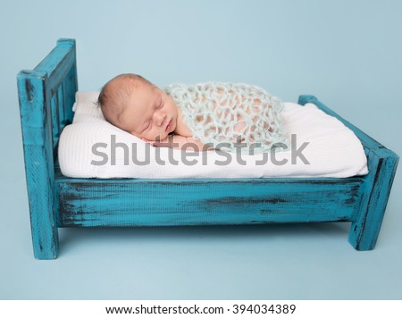Newborn baby sleeping, asleep on bed - stock photo