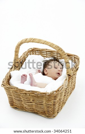 Newborn Baby Sleeping In Basket - stock photo