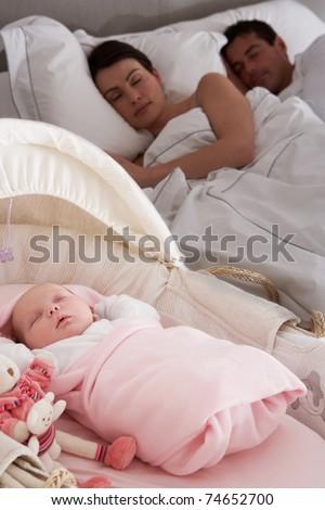 Newborn Baby Sleeping In Cot In Parents Bedroom - stock photo