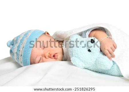 newborn baby sleeping on bed - stock photo