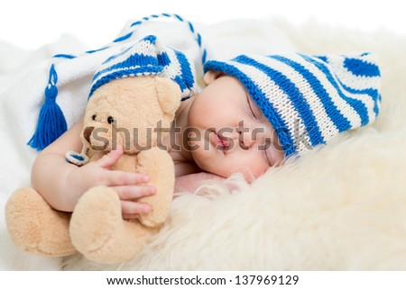 newborn baby sleeping on fur bed - stock photo