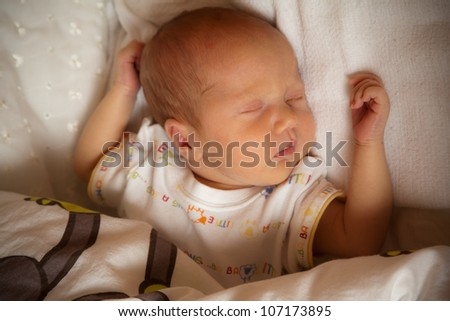 Newborn baby sleeping on the bed, selective focus - stock photo