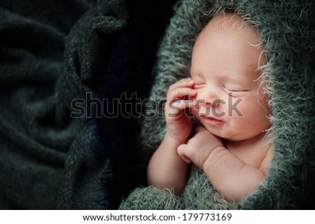 Newborn Baby Sleeping Perfectly with hands - stock photo