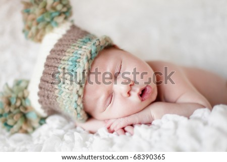 Newborn baby sleeping. Soft focus, shallow DoF. - stock photo