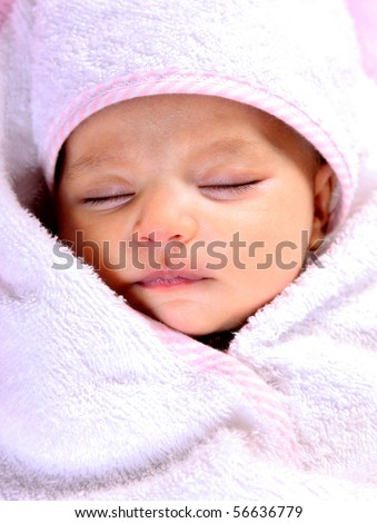 Newborn baby sleeping with a white towel - stock photo