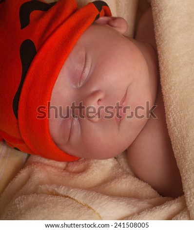newborn baby sleeps in a crib