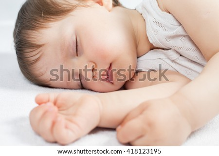 Newborn baby sweet sleeping on a white bed. Comfortable bed. Concept of baby care. Care concept. Healthy sleep. Healthcare