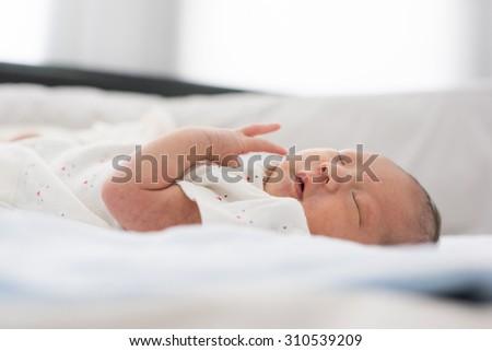 Newborn baby taking a nap - stock photo