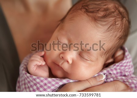 Newborn baby tender sleeping on wool couturier blanket. Pure human family value love faith humanity care.