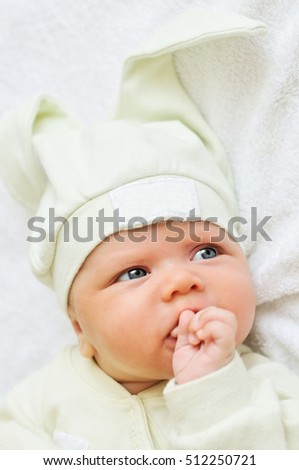 newborn baby wearing funny hat with ear