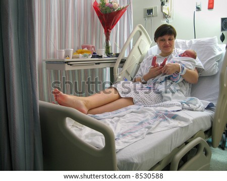 newborn baby with mother in hospital - stock photo