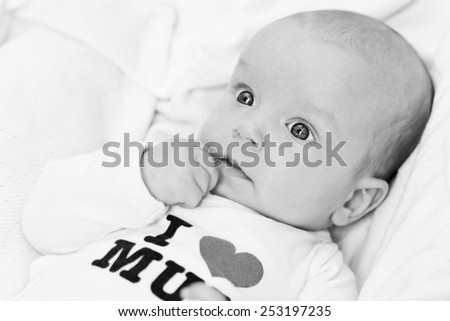 newborn boy wearing clothing with love to mum  (not trademark) ( black and white ) - stock photo