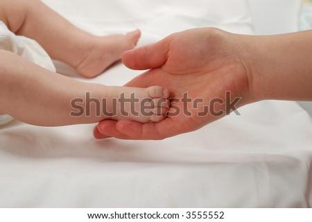 newborn child feet - stock photo