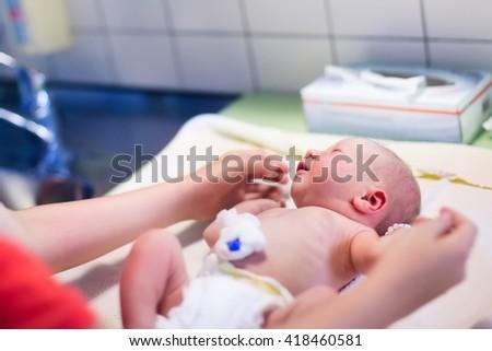 Mother Using Baby Nasal Aspirator She Stock Photo