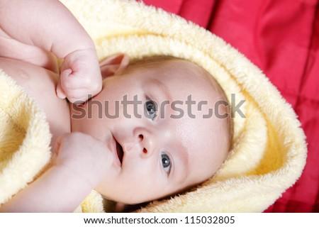 Newborn - close-up focus baby boy with yelow blanket - stock photo