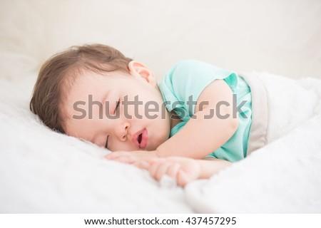 Newborn cute baby sleeping. Closeup portrait, caucasian child - stock photo