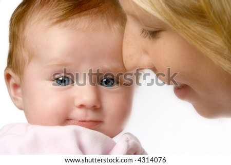 Newborn girl in pink with clear blue eyes, held  by her loving mom. - stock photo