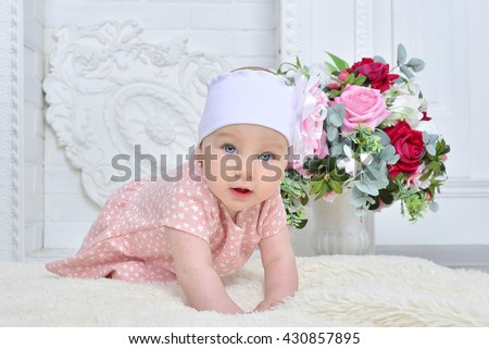newborn girl with bow and flowers - stock photo