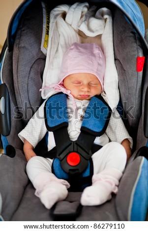 Newborn in car seat - stock photo