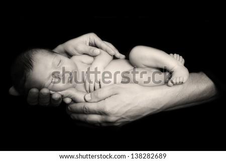newborn in parents hands - stock photo