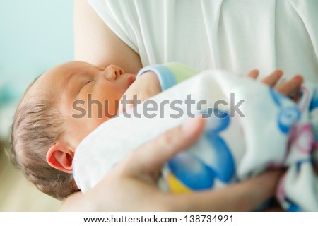 newborn in the maternity ward - stock photo