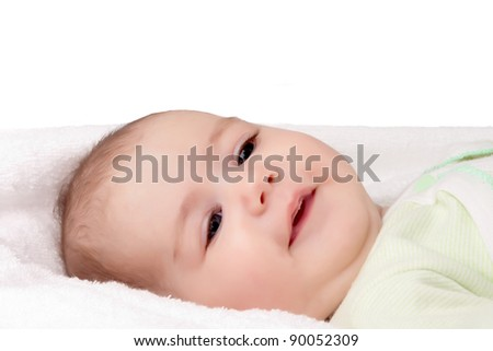 newborn in the towel on a white background