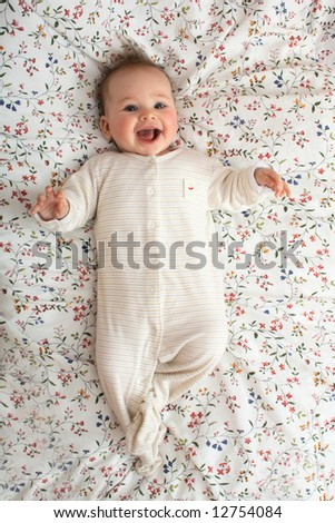 newborn is smiling - stock photo