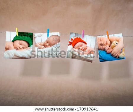 newborn photos attached clothespins on rope - stock photo