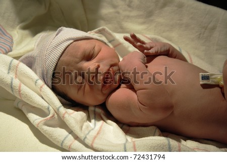 Newborn resting after delivery. - stock photo