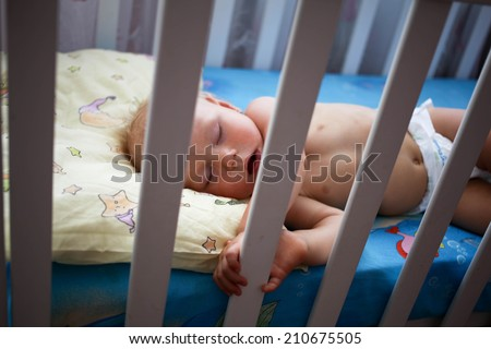 newborn sleep in crib - stock photo