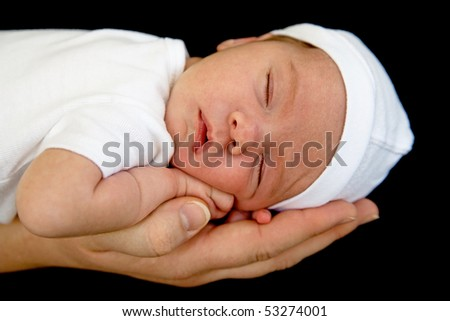 Newborn Sleeping on Mother's Hand - stock photo