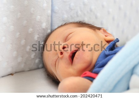 Newborn smiling in his dream - stock photo