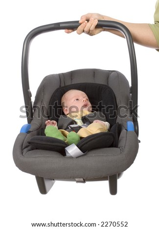 newborn (3 weeks old) boy in the Child Car Seat - stock photo