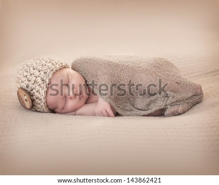 Newborn with Beany - stock photo