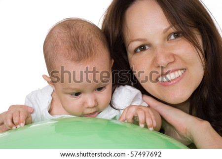 newborn with her mother sitting at the desk
