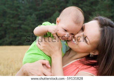 newborn with smiling mother - stock photo