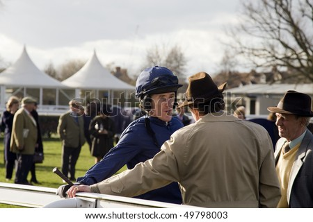 NEWBURY, BERKS - MAR 27: Champion Jockey A P (Tony) McCoy talks to trainer Nicky Henderson after the 7th race at Newbury Racecourse, UK, March 27, 2010 in Newbury, Berks