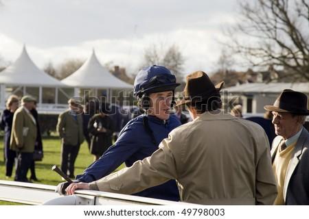NEWBURY, BERKS - MAR 27: Champion Jockey A P (Tony) McCoy talks to trainer Nicky Henderson after the 7th race at Newbury Racecourse, UK, March 27, 2010 in Newbury, Berks - stock photo