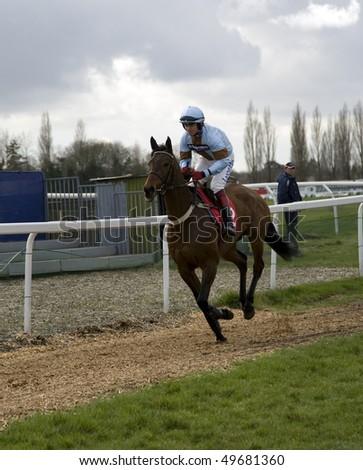 """NEWBURY, BERKS- MAR 27:  Jockey Robert """"chocolate"""" Thornton takes asturienne down to the start of the 3rd race at Newbury Racecourse, UK, March 27, 2010 in Newbury, Berks - stock photo"""