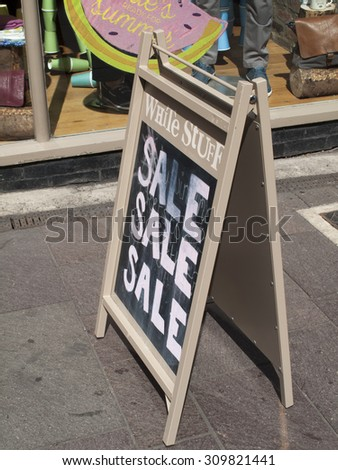 Newbury, Market Place, Berkshire, England - August 7, 2015: White Stuff women and men clothing store end of summer sale