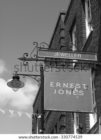 Newbury, Northbrook Street, Berkshire, England - August 07, 2015: Ernest Jones jewellers shop sign above store established 1949 with over 180 stores across the UK