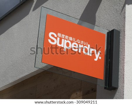 Newbury, Parkway Shopping Centre, Berkshire, England - August 21, 2015: Superdry sign products combine vintage Americana styling with Japanese inspired graphics - stock photo