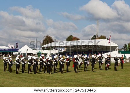 NEWBURY, UK - SEPTEMBER 21: A local military brass band open the days events with a selection of marching songs for the public to watch at the Berks County show on September 21, 2014 in Newbury - stock photo