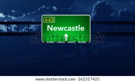 Newcastle Australia Highway Road Sign at Night - stock photo