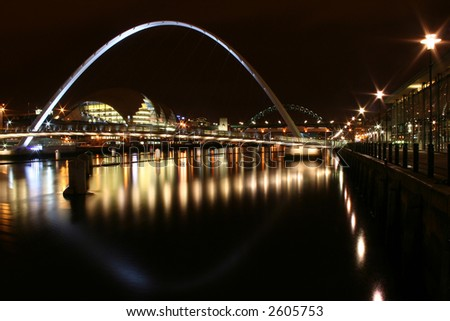 Newcastle bridges, shot from the quayside at newcastle reflected in the still Tyne - stock photo
