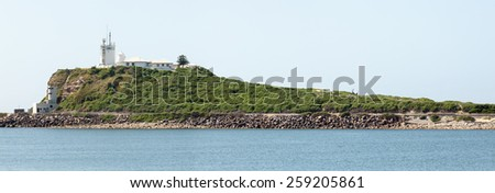 Newcastle is 6th largest city in Australia, industrial but with beautiful beaches, very large port. - stock photo