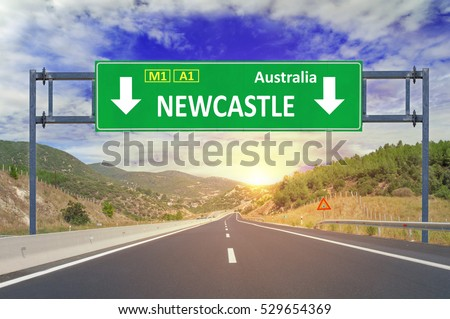 Newcastle road sign on highway