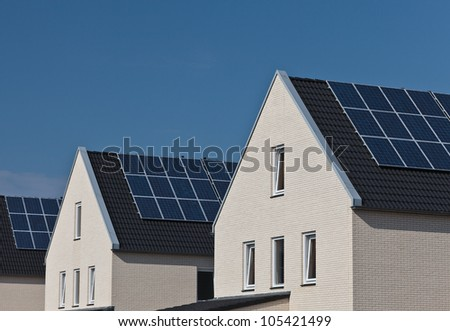 Newly build family homes with solar panels attached to the roof - stock photo